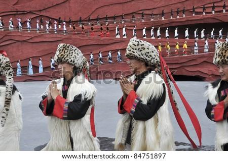 """LIJIANG, CHINA - JULY 4:Actors participate in """"Impression Lijiang"""" live performance on July 4, 2010 at Yunnan Lijiang Ganhaizi Blue Moon Theater in Lijiang, China."""