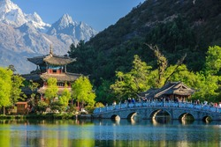 Lijiang old town scene-Black Dragon Pool Park. you can see Jade Dragon Snow Mountain in the background.