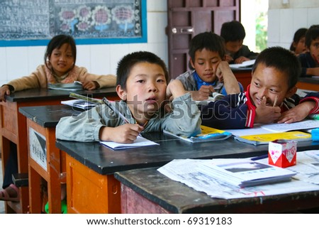 LIJIANG - SEPTEMBER 1: Chinese primary school students start school on September 1 2010, in Lijiang, China. Students face a lot of hardship in the Chinese school system.