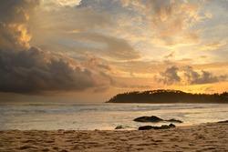 Like an atomic explosion, clouds gathering at the horizon at the tropical beach of Mirissa, Sri Lanka. Double exposure shot taken at dusk during monsoon season.
