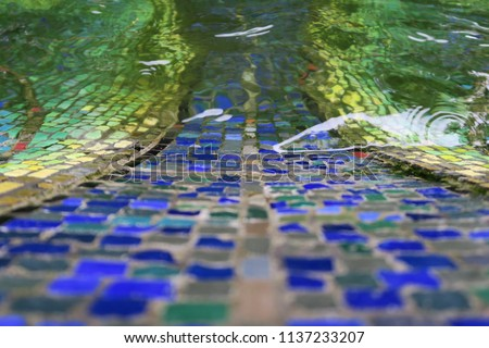 Like an old blue mosaic path leading in the water in a fountain in Germany Photo stock ©