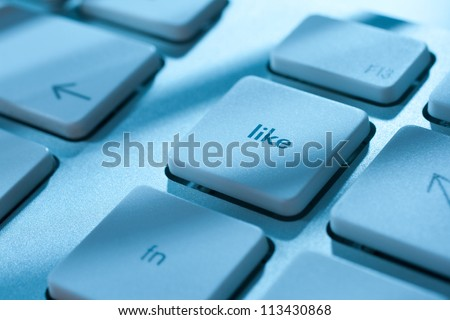 Like button on computer keyboard - social network concept.