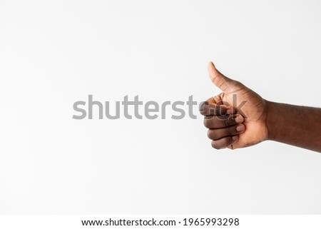 Like gesture. Black lives matter. Support encourage. Good job. Unrecognizable african male hand showing thumb up isolated white copy space. Advertising background. Stock photo ©