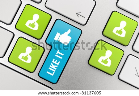 Like it words with thumbs up symbol on modern aluminum keyboard stock