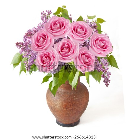 Lilac and roses bunch in vase isolated on white background