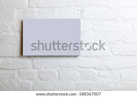 lilac blank poster in a white brick wall. Template Mock up for your content. #588367007