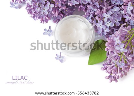 Lilac flowers and cosmetic cream isolated on white background. Natural cosmetic concept #556433782