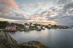 Lillesand, Norway - November 7, 2017: Ulvoysund, ocean and old houses on the Ytre Ulvoya in evening light.