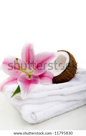 Lilly flower, coco nut and towels