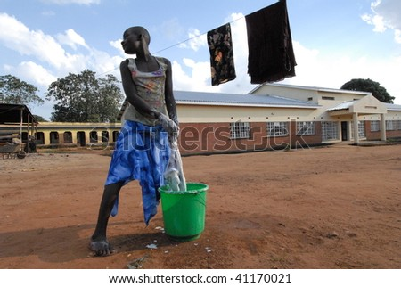 LILONGWE, MALAWI - MAY 30: An orphan washing clothes outside of the Chisom orphanage in Lilongwe Malawi on May 30, 2008.