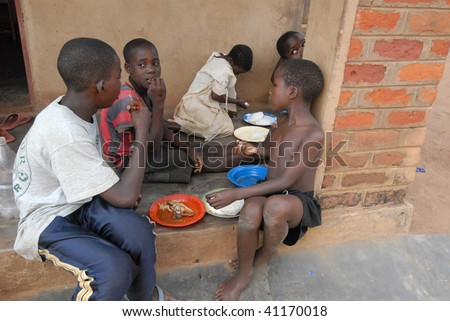 LILONGWE, MALAWI - MAY 30: Children eat at the Chisom orphanage in Lilongwe, Malawi on May 30, 2008.