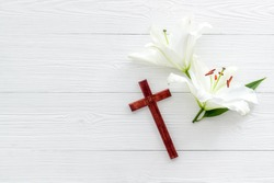 Lily funeral flower with cross. Condolence card with copy space