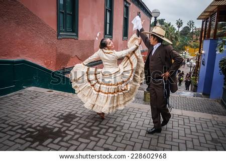LIMA, PERU - CIRCA 2011: Marinera dancers perform a dance in the street of Barranco town circa 2011, in Lima, Peru.