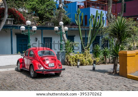 Lima, Peru - MARCH 23, 2016:  Old red car in Barranco district, documentary editorial.