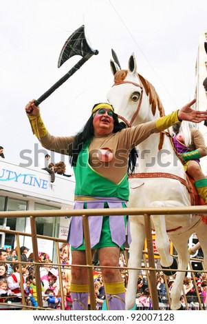 LIMASSOL,CYPRUS-MARCH 6, 2011: Unidentified people in amazonian costumes during the carnival parade, established in 16th century, influenced by Venetians.