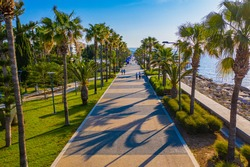 Limassol. Cyprus. Promenade seafront Molos. Walking path in the Park Molos. The Mediterranean sea coast. The Cyprus beaches. Vacation in Cyprus. alley with palm trees.