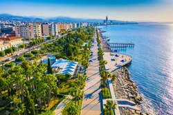 Limassol. Cyprus. The seafront of Limassol Molos bay panorama by drone. Hotels on Limassol waterfront from a height. Mediterranean. Cyprus beaches. Hotel vacation on the coast of Cyprus.