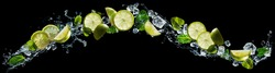 Lime and lemon pieces with mint and ice in water splash
