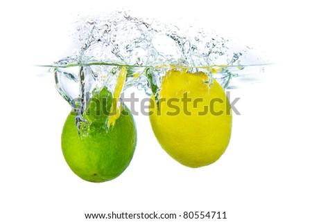 lime and lemon splashing water isolated on white background