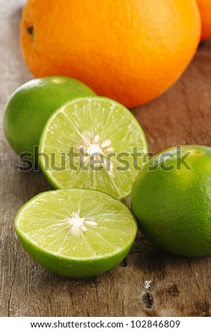 lime and orange on wooden background