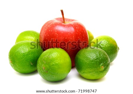 Lime and red apple isolated on white background