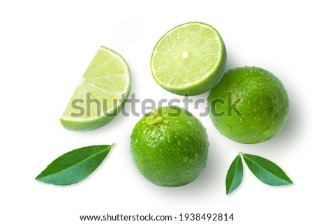 Lime fruits with green leaf and cut in half slice isolated on white background. Top view. Flat lay.