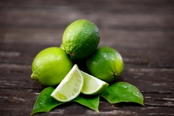 lime juice with lime slices on wooden table. Detox diet
