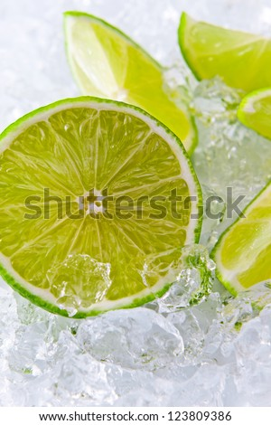 lime pieces and ice, focus on a center.