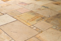 Lime-sandstone slabs laid irregularly on the terrace