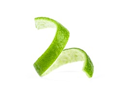 Lime skin isolated on a white background. Green lemon twist.