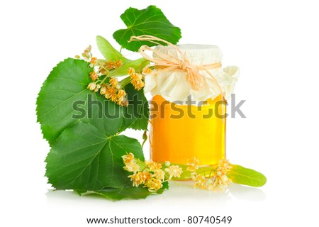Lime tree honey. Sweet honey for tee with lime tree flowers and leaf isolated on white background