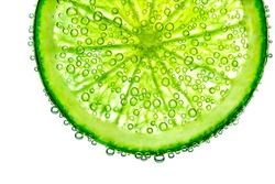 lime with bubbles in water isolated on white background