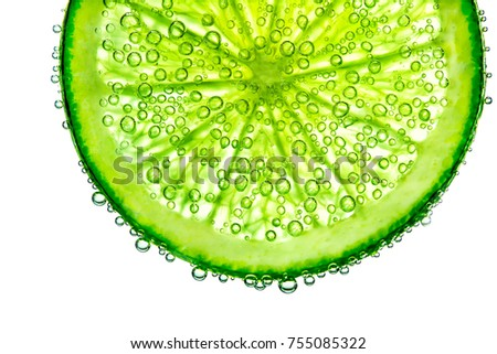 lime with bubbles in water isolated on white background #755085322