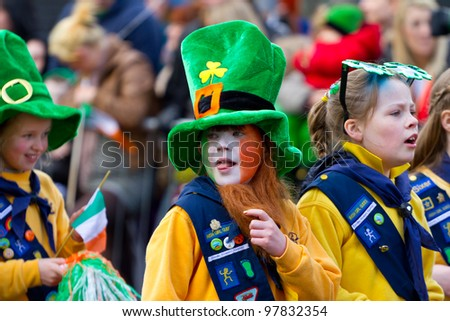 LIMERICK, IRELAND - MARCH 17: Unidentified children in Irish hat participate in a parade for St. Patrick's Day. It's a traditional Irish holiday celebration. March 17, 2012 in Limerick, Ireland.