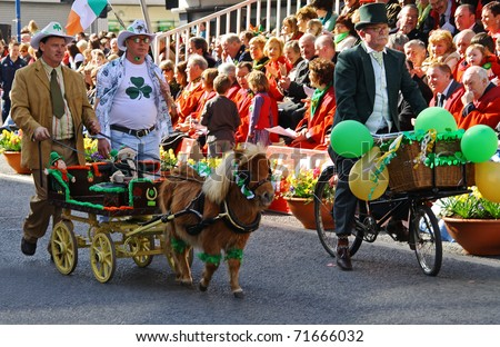 LIMERICK, IRELAND - MARCH 17: Unidentified people with a pony participate in a parade for St. Patrick's Day on March 17, 2009 in Limerick, Ireland. It's a traditional Irish holiday parade.
