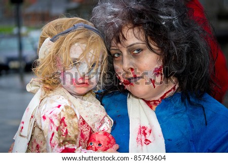 LIMERICK, IRELAND - OCTOBER 1:  Portrait of unidentified woman with child in zombie costumes on the street of Outbreak Limerick Zombie Festival on October 1st, 2011 in Limerick, Ireland