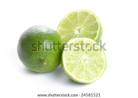 Limes cut in half isolated on white