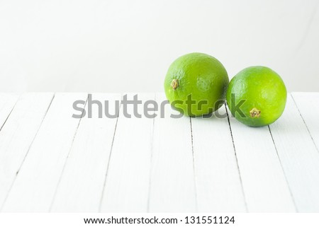 limes on white table
