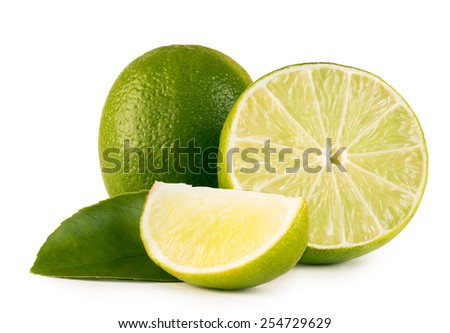 Limes with slices and leaves isolated on white background #254729629