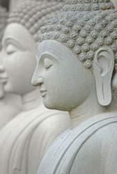 Limestone Buddhist state in Wat Pha Sawang Boon Nakornnayok Thailand