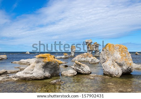 "Limestone formations on Faroe island in Gotland, Sweden. These rocks are called ""raukar"" in Swedish. - stock photo"