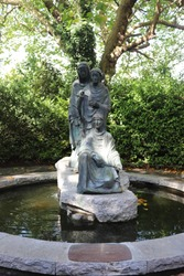 Limestone Fountain with Bronze statue of the Three Fates gifted to the Irish, located in Saint Stephen's Green, Dublin Ireland