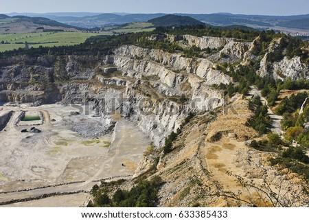 Limestone mine in Koneprusy, Czech Republic. Deep opencast mines leave great environmental impact. Stock photo ©