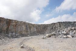 Limestone mining, free face for blasting in limestone mining.