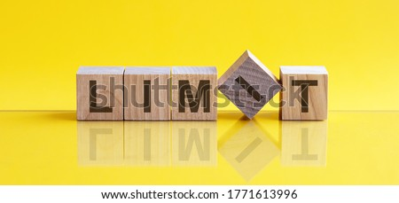 limit word written on wood block. limit text on table, yellow background, concept. Foto d'archivio ©