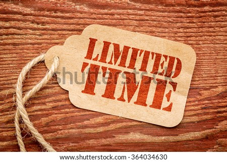 limited time offer sign - red stencil text on a paper price tag against rustic wood #364034630