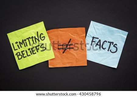 limiting beliefs are not facts concept - handwriting on sticky notes against black paper background - Shutterstock ID 430458796