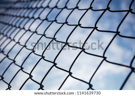 Limitless boundaries concept.  Sky through chain link fence in bokeh background, wallpaper. #1141639730
