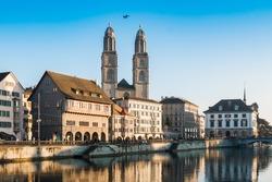 Limmat River Quay and Grossmunster Church in Zurich, Switzerland