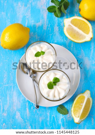 Limoncello - italian Dessert.  Lemon Cheesecake Mousse with Whipped Cream in cups. Summer dessert. Top view